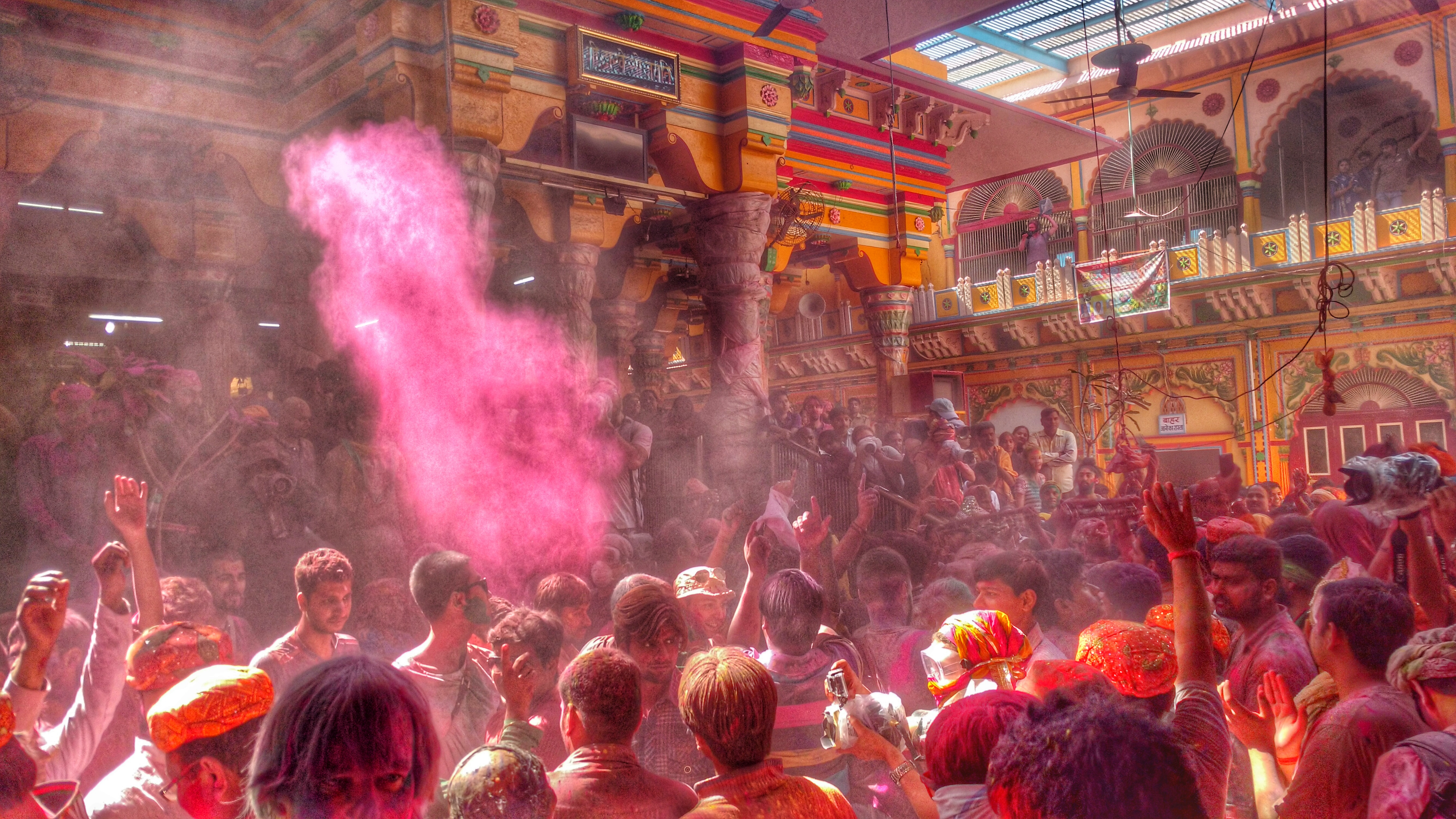 The colorful Dwarkadheesh Temple and its vibrant devotees in a jovial mood